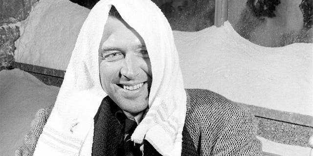 "Actor Jimmy Stewart smiling during a break in filming on the set of the movie ""It's A Wonderful Life."""