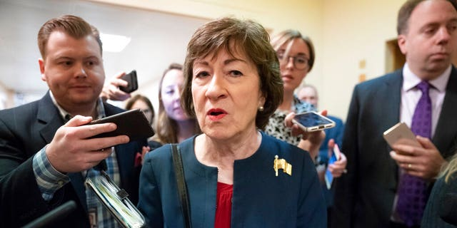 FILE - In this Nov. 6, 2019, file photo, Sen. Susan Collins, R-Maine, is surrounded by reporters as she heads to vote at the Capitol in Washington. U.S. Sen. Collins officially launched her bid for a reelection Wednesday, Dec. 18, setting up an expensive and closely watched battle for the seat the moderate Republican from Maine has held for nearly 24 years. (AP Photo/J. Scott Applewhite, File)