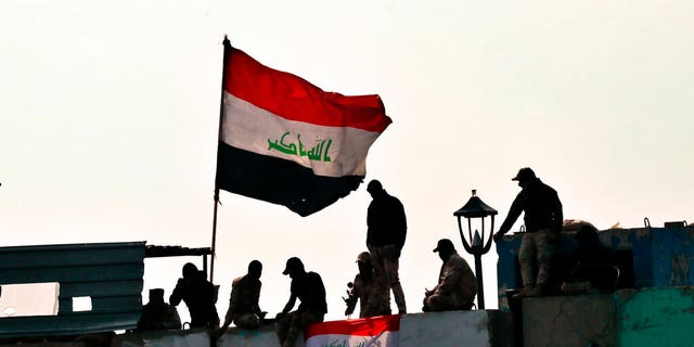 Security forces close the Ahrar Bridge during ongoing anti-government protests in Baghdad, Iraq, Monday, Dec. 9.