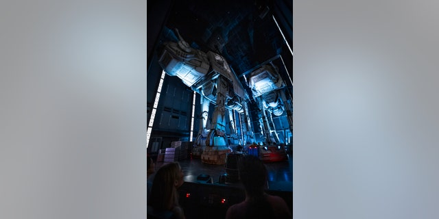 Guests race past massive AT-AT walkers aboard a First Order Star Destroyer as part of the groundbreaking new attraction.