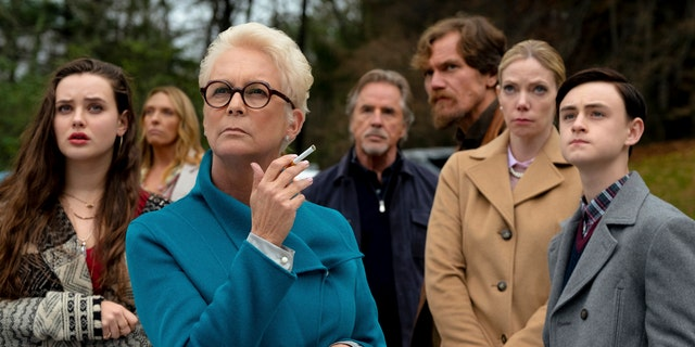 "Katherine Langford, Toni Collette, Jamie Lee Curtis, Don Johnson, Michael Shannon, Riki Lindholm and Jaeden Lieberher in a scene from ""Knives Out."" (Claire Folger/Lionsgate via AP)"