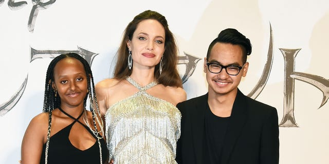 Angelina Jolie stands with daughter Zahara Marley and son Maddox, who she shares with Brad Pitt. (Photo by Jun Sato/WireImage)