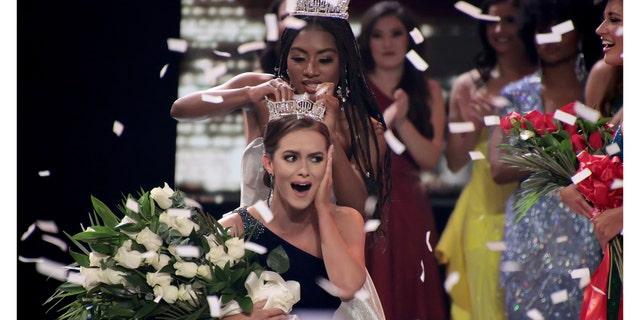 Miss America 2019 Nia Franklin crowns Miss Virginia 2019, Camille Schrier, as Miss America 2020 on Dec. 19 in Uncasville, Conn.