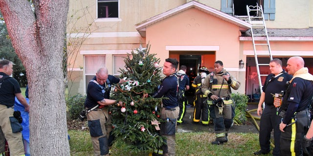 """""""All of the family's gifts and tree were able to be retrieved undamaged,"""" the fire department wrote online."""