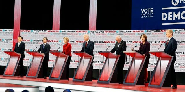 Democratic presidential candidates from left, entrepreneur Andrew Yang, South Bend Mayor Pete Buttigieg, Sen. Elizabeth Warren, D-Mass., former Vice President Joe Biden, Sen. Bernie Sanders, I-Vt., Sen. Amy Klobuchar, D-Minn., and businessman Tom Steyer stand on stage during a Democratic presidential primary debate Thursday, Dec. 19, 2019, in Los Angeles. (AP Photo/Chris Carlson)