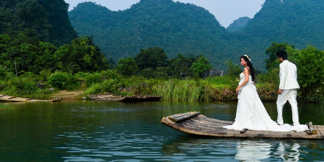 Actors stage a wedding on the Li River, in the Guangxi Province of China.