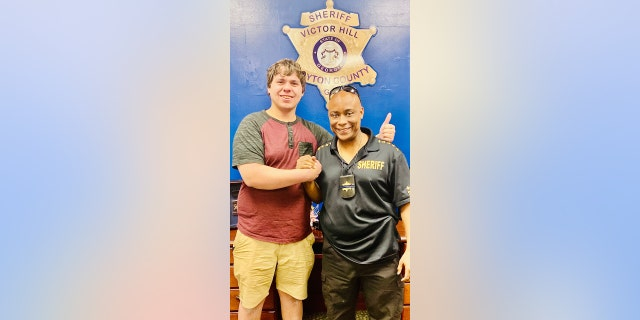 Bread deliveryman Joseph Chilton with Clayton County Sheriff Victor Hill.