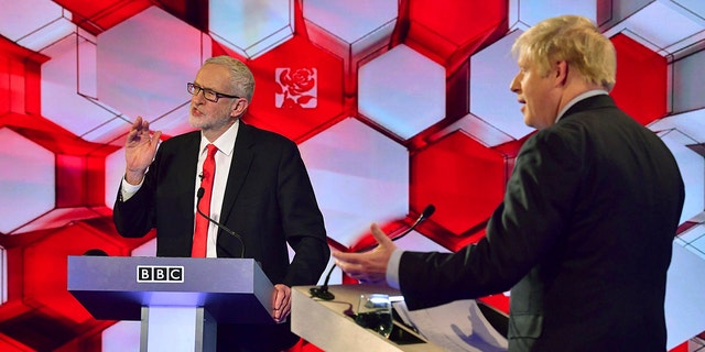 Opposition Labour Party leader Jeremy Corbyn, left, and Britain's Prime Minister Boris Johnson, during a head to head live Election Debate at the BBC TV studios in Maidstone, England, Friday Dec. 6, 2019. (Associated Press)