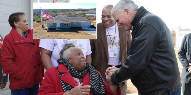 Franklin Graham, the president of Samaritan's Purse, shakes hands with Earnestine Reese, after revealing her new home that was destroyed by tornadoes in March.