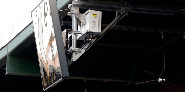 FILE - In this July 10, 2019, file photo, a radar device hangs from the roof behind home plate at PeoplesBank Park during the third inning of the Atlantic League All-Star minor league baseball game in York, Pa.  (AP Photo/Julio Cortez, File)