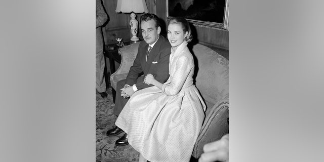 In this Jan. 5, 1956 file photo, actress Grace Kelly and Prince Rainier III of Monaco sit arm-in-arm as they meet the press in Philadelphia, Pa, USA.