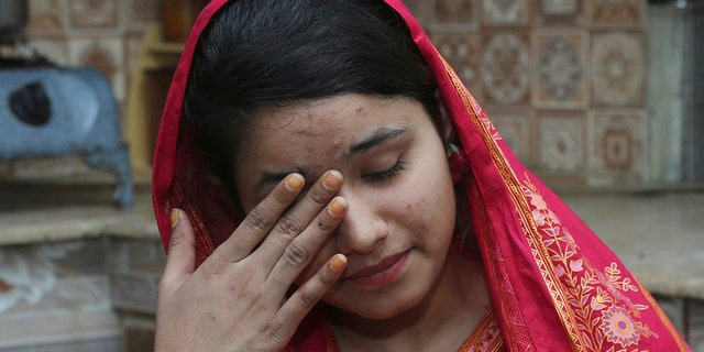 FILE - In this April 14, 2019 file photo, Pakistani Christian Mahek Liaqat, who married a Chinese national, cries as she narrates her ordeal, in Gujranwala, Pakistan. (AP Photo/K.M. Chaudary, File)