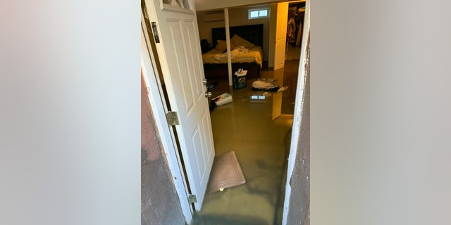 Sewage backup floods Cynthia McKenzie's home on Nov. 30, 2019, in the Jamaica, Queens, section of New York. Officials say a water condition is causing human waste to back up into several hundred homes in the area there. (Cynthia McKenzie via AP)