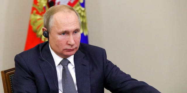 Russian President Vladimir Putin attends a corner video discussion with Chinese President Xi Jinping Monday.