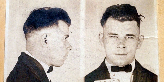 This undated file photo shows Indiana Reformatory booking shots of John Dillinger, stored in the state archives. A judge on Wednesday dismissed a lawsuit filed by a relative of the 1930s gangster against an Indianapolis cemetery who wants to exhume Dillinger's gravesite to determine if the notorious criminal is actually buried there. (Indiana State Archives/The Indianapolis Star via AP, File)