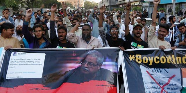 Dec. 3, 2019, photo, indignant Islamists intone slogans during a proof opposite an eccentric Pakistani journal Dawn, during outward a Press Club in Karachi, Pakistan. (AP Photo/Fareed Khan)