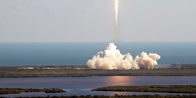 A Falcon 9 SpaceX rocket on a resupply mission to the International Space Station lifts off from Space Launch Complex 40 at Cape Canaveral Air Force Station in Cape Canaveral, Fla., on Thursday. (AP Photo/John Raoux)