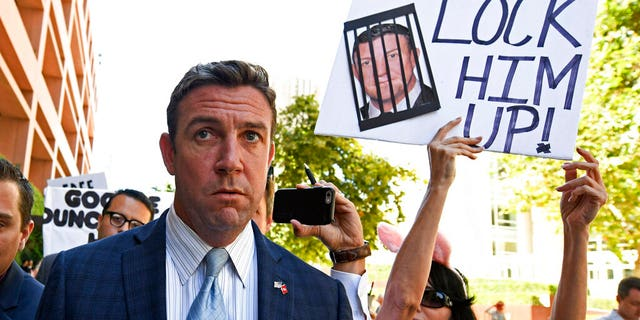 In this July 1, 2019, file photo, U.S. Rep. Duncan D. Hunter, R-Calif., leaves federal court after a hearing in San Diego. Hunter has indicated he's on his way out of office. (AP Photo/Denis Poroy, File)