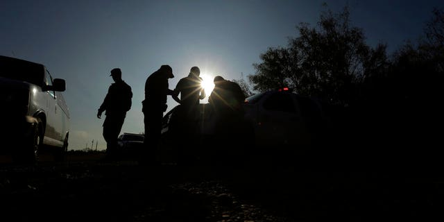 Border Patrol agents apprehending a man thought to have entered the country illegally, near McAllen, Texas, along the U.S.-Mexico border.