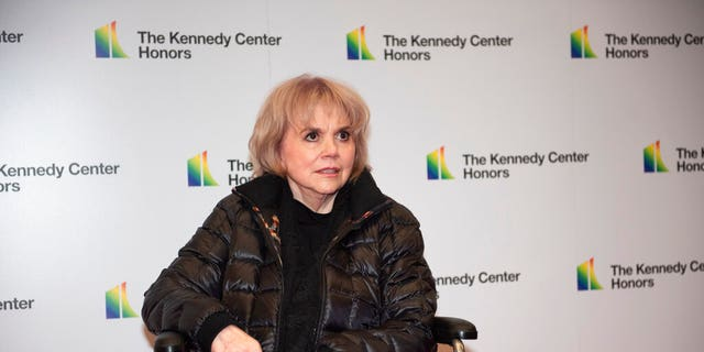 2019 Kennedy Center Honoree singer Linda Ronstadt arrives at the State Department for the Kennedy Center Honors State Department Dinner on Saturday, Dec. 7, 2019. (AP Photo/Kevin Wolf)