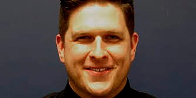 ​​​​​​​Houston police Sgt. Christopher Brewster, seen in an undated photo, was shot and killed Saturday evening, Dec. 7, 2019, by a man who had been reported for assault, authorities say. (Houston Police Department via AP)