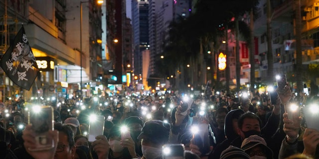 Pro-democracy protesters march on a street during a protest in Hong Kong, Sunday, Dec. 8, 2019. Thousands of people took to the streets of Hong Kong on Sunday in a march seen as a test of the enduring appeal of an anti-government movement about to mark a half year of demonstrations. (AP Photo/Vincent Yu)