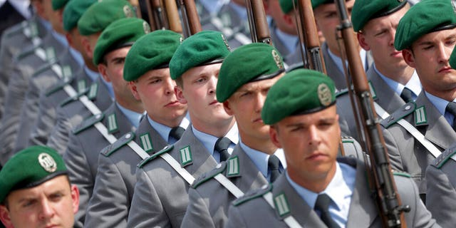 Soldiers attend an oath-taking ceremony of the German army at the Defence Ministry in Berlin, Germany.