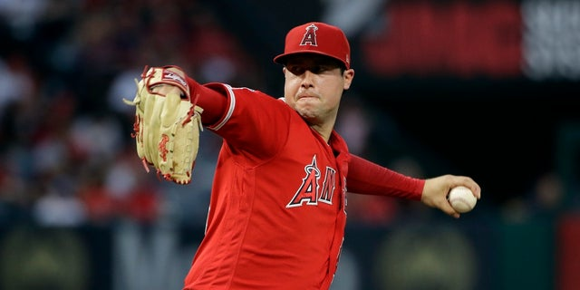 In this June 29, 2019, file photo, Los Angeles Angels starting pitcher Tyler Skaggs throws to the Oakland Athletics during a baseball game in Anaheim, Calif. Talks to add testing for opioids began following the death of Skaggs, who was found dead in his hotel room in the Dallas area July 1 before the start of a series against the Texas Rangers. (AP Photo/Marcio Jose Sanchez, File)