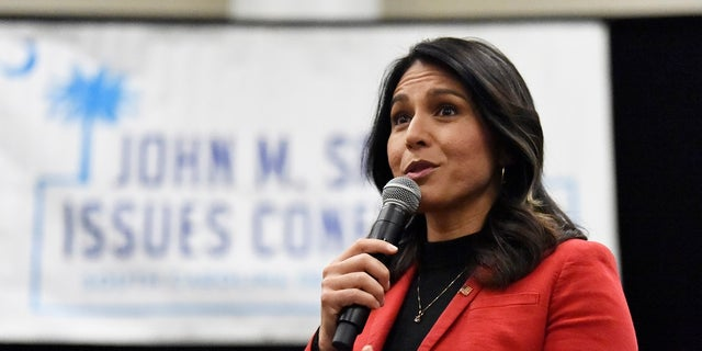 "Democratic presidential candidate U.S. Rep. Tulsi Gabbard, D-Hawaii speaks to Democrats gathered at the Spratt Issues Conference in Greenville, S.C., Saturday, Dec. 14, 2019. Gabbard voted ""present"" on both articles of impeachment against President Trump on Wednesday. (AP Photo/Meg Kinnard)"