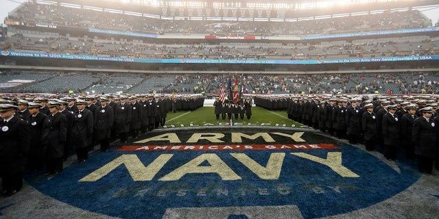 Navy midshipmen march before an NCAA college football game against Army on Dec. 14 in Philadelphia. A probe by both service academies into hand gestures displayed by West Point cadets and Naval Academy Midshipmen that were captured on national television concluded the signs were not intended to be racist. (AP Photo/Matt Slocum)