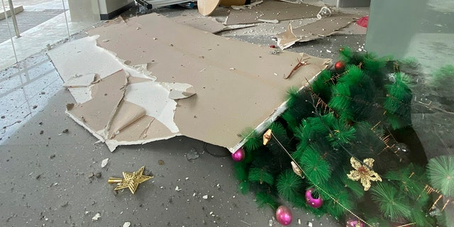 ​​​​​​​A toppled Christmas tree and other debris are seen inside a building after a strong earthquake shook Digos, Davao del Sur province, southern Philippines on Sunday Dec. 15, 2019. (Philippine Red Cross via AP)
