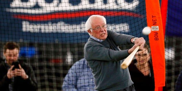 Sen. Bernie Sanders, I-Vt., hitting a baseball after a meeting with minor-league baseball players and officials Sunday in Burlington, Iowa. (AP Photo/Charlie Neibergall)