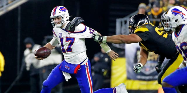 Buffalo Bills quarterback Josh Allen (17) is tackled by Pittsburgh Steelers defensive end Cameron Heyward (97) during the second half of an NFL football game in Pittsburgh, Sunday, Dec. 15, 2019.