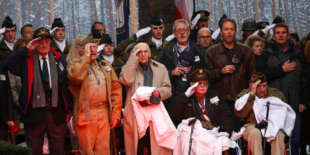 U.S. Battle of the Bulge veterans, front row, listen to the U.S. national anthem during a ceremony to commemorate the 75th anniversary of the Battle of the Bulge at the Mardasson Memorial in Bastogne, Belgium on Monday, Dec. 16, 2019. The Battle of the Bulge, also called Battle of the Ardennes, took place between Dec. 1944 and Jan. 1945 and was the last major German offensive on the Western Front during World War II.