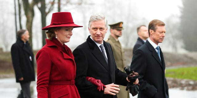 Belgium's King Philippe, center, Belgium's Queen Mathilde and Luxembourg's Grand Duke Henri, right, leave at the end of a ceremony to commemorate the 75th anniversary of the Battle of the Bulge at the Mardasson Memorial in Bastogne, Belgium on Monday, Dec. 16, 2019.