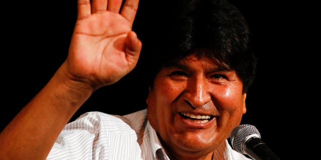 Bolivia's former President Evo Morales waves during a press conference in Buenos Aires.