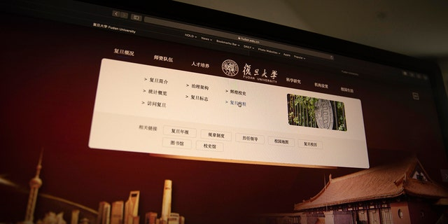 A computer screen shows the website of Fudan University with a link to the University charter in Beijing on Thursday, Dec. 19, 2019. (AP Photo/Ng Han Guan)