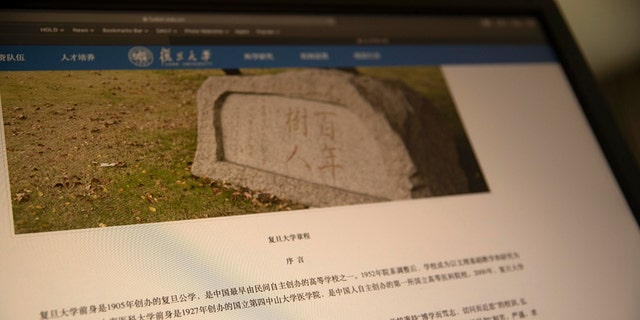 """A website with the revised charter for Fudan University is shown on a computer screen in Beijing on Thursday, Dec. 19, 2019. Controversy has erupted after the leading Chinese university revised its charter to remove a reference to """"free thinking"""" and adding a new stress on adhering to the leadership of the ruling Communist Party, Marxism and socialist theories of education.(AP Photo/Ng Han Guan)"""