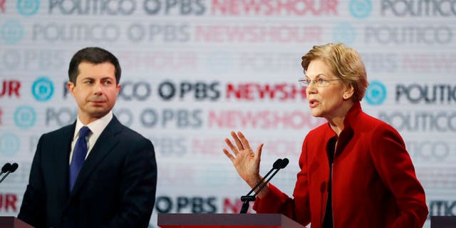Democratic presidential candidate Sen. Elizabeth Warren, D-Mass., right, speaks as South Bend Mayor Pete Buttigieg listens during a Democratic presidential primary debate Thursday, Dec. 19, 2019, in Los Angeles. (AP Photo/Chris Carlson)