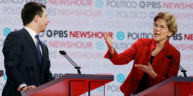 Democratic presidential candidate Sen. Elizabeth Warren, D-Mass., speaks as South Bend, Ind., Mayor Pete Buttigieg listens during a Democratic presidential primary debate Thursday in Los Angeles. (Associated Press)