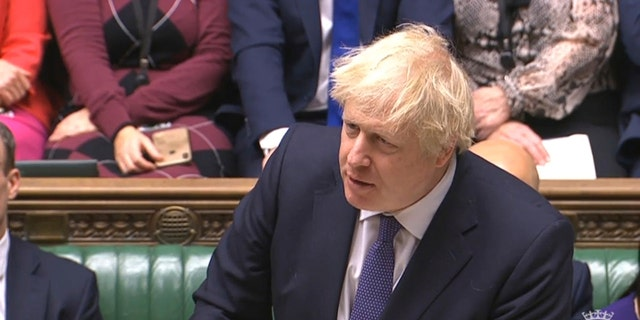 British Prime Minister Boris Johnson speaks during the Brexit debate on The European Union (Withdrawal Agreement) Bill in the House of Commons in London, Friday Dec. 20, 2019. (House of Commons via AP)