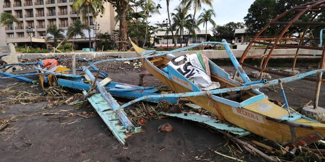 An outrigger boat destroyed by Typhoon Phanfone on the coastline Thursday in Ormoc City, central Philippines.