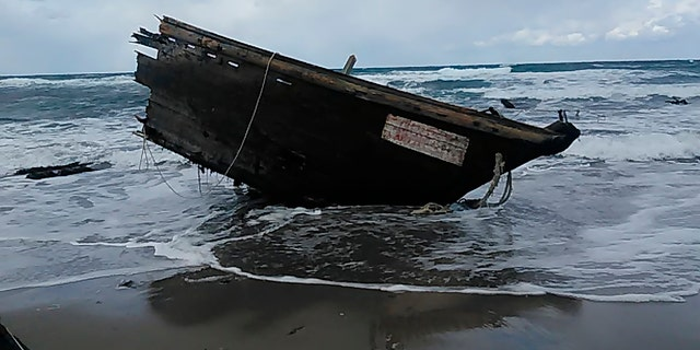 This Saturday, Dec. 28, 2019, photo provided by Sado Coast Guard Station shows a part of a boat on Sado Island, Niigata Prefecture, northern Japan. The boat suspected of being from North Korea with several bodies was found on the small island, the Japanese Coast Guard said Sunday, Dec. 29, 2019. (Sado Coast Guard Station via AP)