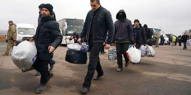 Ukrainian war prisoners released after a prisoner exchange, near Odradivka, eastern Ukraine, on Sunday.