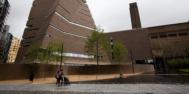 In this Tuesday, June 14, 2016 file photo, an exterior view shows a new building called the Switch House, at left, which has been added on to the Tate Modern gallery in London. London police have charged a man with criminal damage after an attack on a Picasso painting at the Tate Modern gallery. (AP Photo/Matt Dunham, file)
