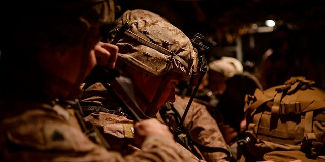 In this photo provided by U.S. Department of Defense, U.S. Marines assigned to Special Purpose Marine Air-Ground Task Force-Crisis Response-Central Command (SPMAGTF-CR-CC) 19.2, preparing to deploy from Kuwait on Tuesday. (U.S. Marine Corps photos by Sgt. Robert G. Gavaldon via AP)