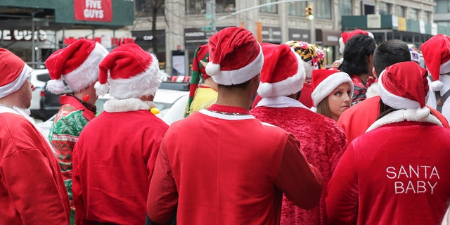 Westlake Legal Group AP_SantaCon 'Santas' subdue stabbing suspect on train after New York City's SantaCon Nicole Darrah fox-news/us/us-regions/northeast/new-york fox-news/us/disasters/transportation fox-news/us/crime fox-news/travel/vacation-destinations/new-york-city fox-news/special/occasions/holiday fox-news/odd-news fox news fnc/us fnc article 61a7f1fc-3818-5509-bf02-4676b80b4eaf