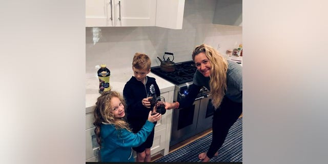 Walsh Jennings, pictured with two of her children, said providing a good nutritional example for her kids is a key part of her parenting.