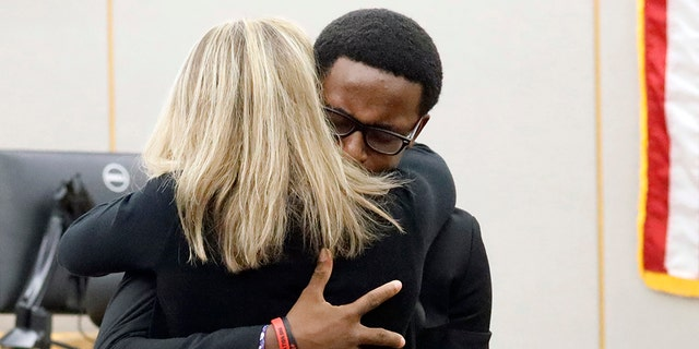 Botham Jean's younger brother Brandt Jean hugs convicted murderer and former Dallas Police Officer Amber Guyger after delivering his impact statement to her after she was sentenced to 10 years in jail, Wednesday, Oct. 2, 2019, in Dallas. (Associated Press)
