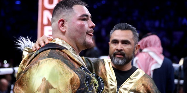 Andy Ruiz Jr. reacts after losing on points to Britain's Anthony Joshua in their World Heavyweight Championship contest at the Diriyah Arena, Riyadh, Saudi Arabia early Sunday Dec. 8, 2019. (Nick Potts/PA via AP)